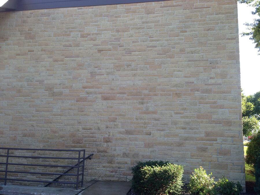 After - Pressure washing block wall.